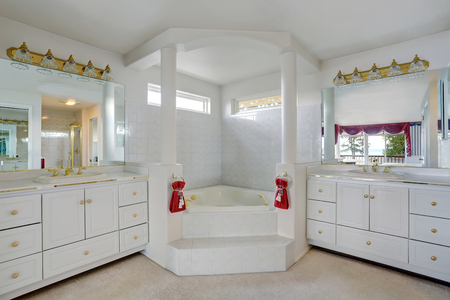 master bath: Luxury large white master bathroom cabinets with double sinks and big bath tub with columns