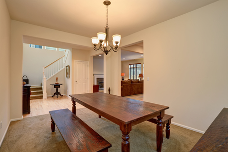 open floor plan: Open floor plan. View of dining room with Carved wooden table, living room and hallway with staircase Stock Photo