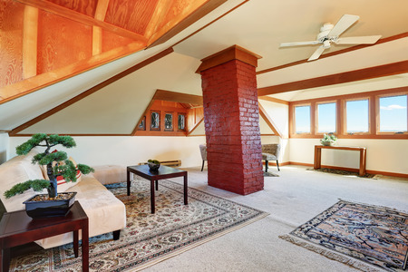 vaulted ceiling: Large upstairs living room with cozy sitting area. There is high vaulted ceiling with brown trim and nice rugs.