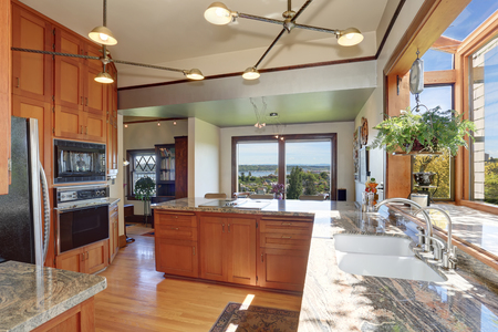 furnished: Great kitchen room with granite counter tops, built-in appliances, pendant lights and light tones cabinets.