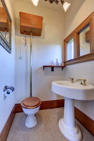 white trim: White vintage bathroom interior with brown trim. Also washbasin stand, toilet,  window and decorative shelf.