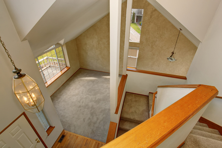 upstairs: Panoramic view of living room and hallway interior from upstairs deck Stock Photo