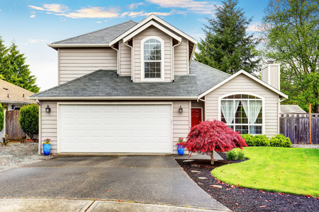 curb appeal: American classic home with beige exterior paint. Beautiful curb appeal.