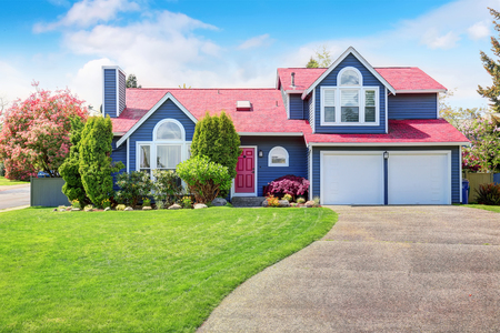 curb: Beautiful curb appeal with blue exterior paint and red roof. Nice front landscape design.