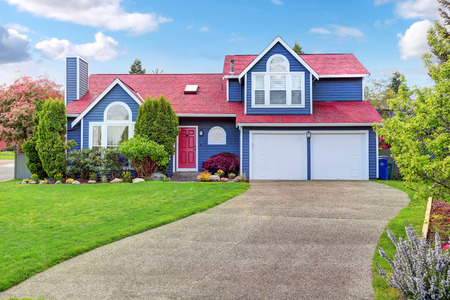 home exterior: Beautiful curb appeal with blue exterior paint and red roof. Nice front landscape design.