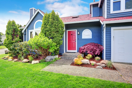 curb appeal: Beautiful curb appeal with blue exterior paint and red roof. Nice front landscape design.