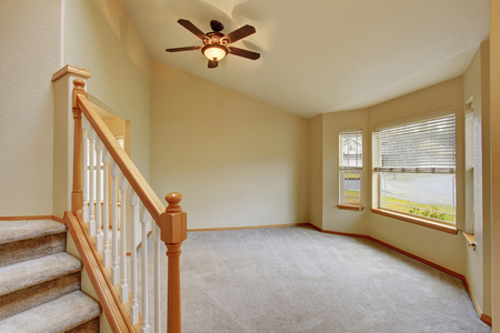 inside house: Empty hallway interior with carpet stairs view. Also carpet floor in the open floor plan room Stock Photo