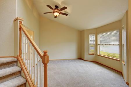 open floor plan: Empty hallway interior with carpet stairs view. Also carpet floor in the open floor plan room Stock Photo
