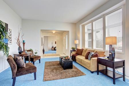 blue carpet: Cozy modern living room with blue carpet floor and beige sofa