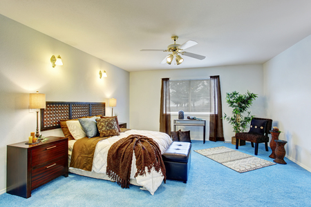 blue carpet: Luxury modern bedroom interior with blue carpet floor, wooden furniture and brown curtains