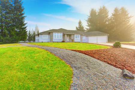 nice house: Nice modern house with driveway and well kept green lawn around Stock Photo