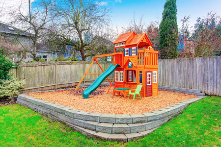 fenced: Fenced backyard with wooden playground for kids