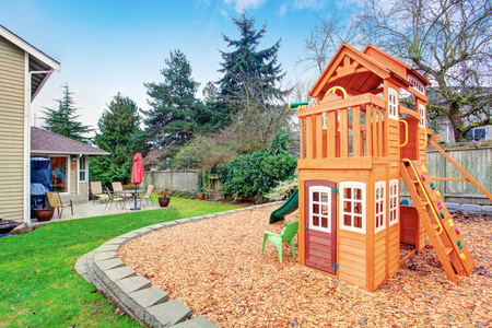 playground: Fenced backyard with wooden playground for kids
