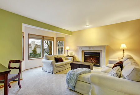 family rooms: Beautiful cozy living room with hardwood floor and fireplace.