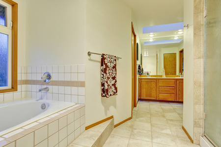bathroom tile: Nice master bathroom with tub and tile floor.