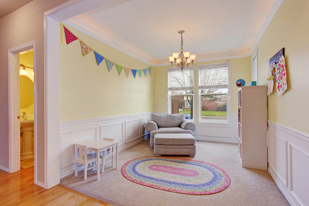 room: Cute kids play room with white carpet floor and rug Stock Photo
