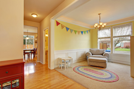 play room: Cute kids play room with white carpet floor and rug Stock Photo