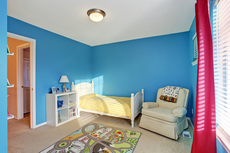 kids room: Cute kids room with blue walls, carpet and red curtains