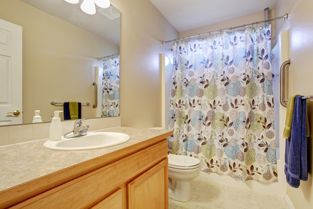 classic interior: Classic American bathroom interior with vanity cabinet and white sink Stock Photo
