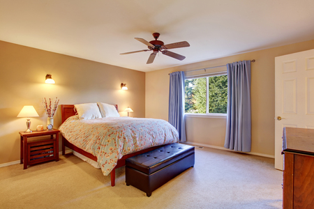 master bedroom: Beautiful master bedroom with carpet, window and blue curtains Stock Photo
