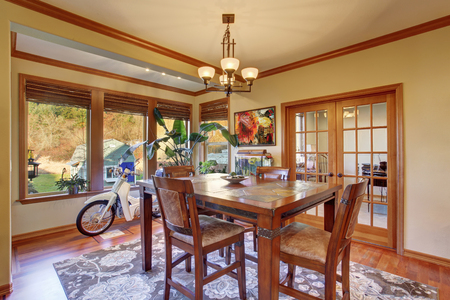 Dining area with hardwood floor and rug. Wooden table set