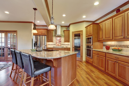 counter top: Kitchen interior with island. Wooden cabinets with granite counter top and hardwood floor Stock Photo