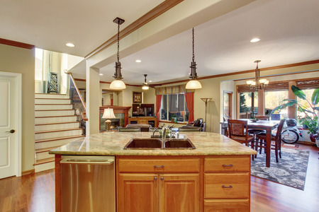 modern living: Open floor plan with kitchen, living room and dining area. View of kitchen island with sink