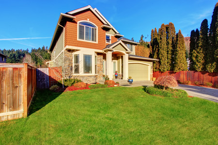 curb: Classic house with garage, driveway, and grassy front yard. Curb appeal Stock Photo