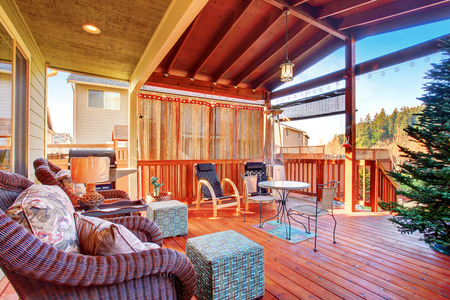 skylights: Exterior covered patio with furniture. Wood ceiling with skylights.
