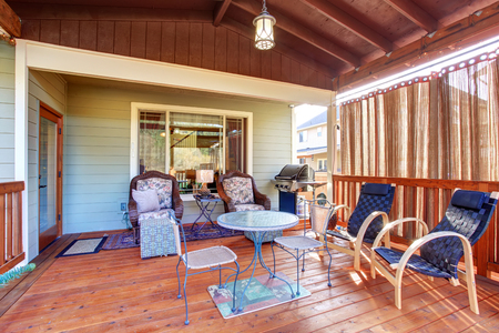 porches: Exterior covered patio with furniture. Wood ceiling with skylights.