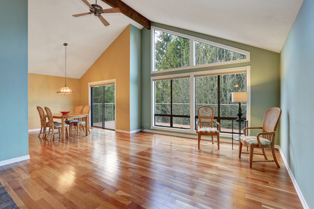 hardwood: Empty room with dining area with hardwood floor and big windows Stock Photo