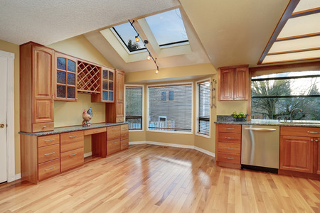 hardwood floor: Kitchen with nice counters, stained cabinets and hardwood floor Stock Photo