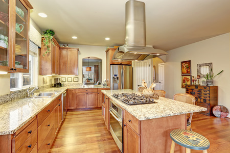wood stove: Classic large wood kitchen interior with hardwood floor, breakfast table.