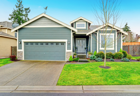 garage on house: Curb appeal. House exterior with blue trim, garage and driveway