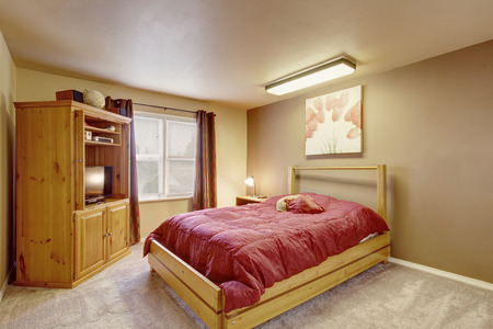 bedroom furniture: Cozy bedroom with wooden furniture, brown curtains and carpet floor