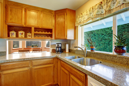 kitchen cabinets: Kitchen room interior with wooden cabinets and granite counter top
