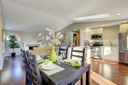 open plan: Open plan floor kitchen room with hardwood floor and dining area Stock Photo