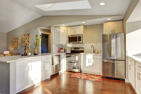 kitchen cabinets: Kitchen room interior with white cabinets, hardwood floor and rug