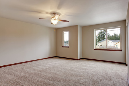 remodeled: Empty room interior with carpet floor and beige walls