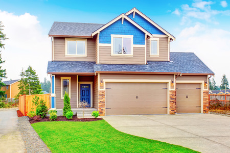garage on house: Beautiful story traditional house with garage and driveway. Stock Photo