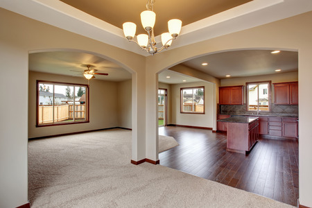 open floor plan: Open floor plan living room interior with carpet floor and fireplace connected with kitchen