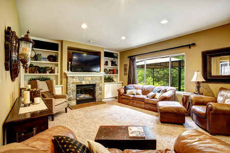 stone fireplace: Living room interior with leather furniture set, stone fireplace and tv Stock Photo