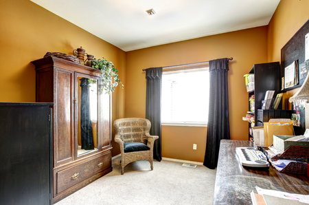 wicker work: Office room interior with antique wardrobe, wicker chair and desk