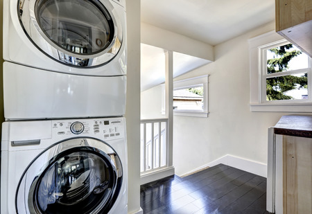 dryer  estate: Laundry room with modern white appliances. Hallway Stock Photo