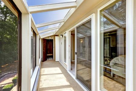 screened: Long screened balcony interior with beige carpet floor Stock Photo