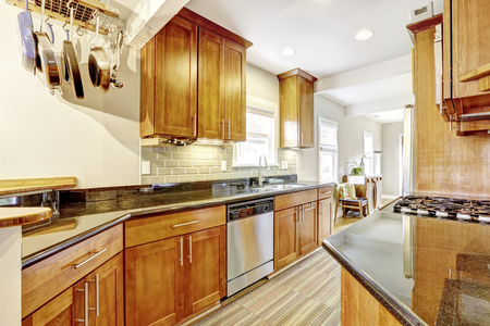 Practical Kitchen Room Interior. Cabinets, Granite Tops And Hanging Pot  Rack. Northwest,