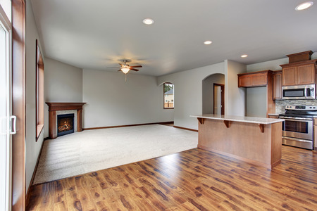 open plan: Large empty living room interior connected with kitchen room. Open plan.
