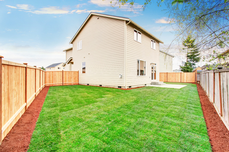 kept: American house fenced back yard exterior  with well kept lawn Stock Photo