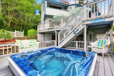 two level house: Large marine style home with two level deck with Jacuzzi on first floor