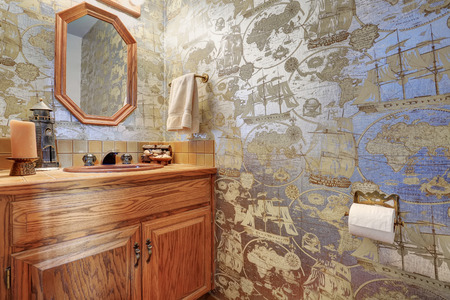 wall paper: Marine style bathroom interior with view of vanity cabinet, mirror and nice decor